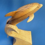 Dolphin carved from Yew stand in Sycamore
