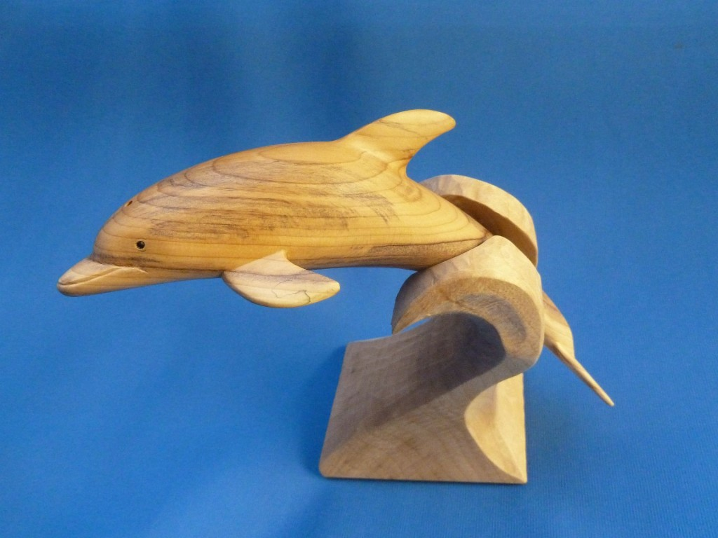 Dolphin carved in Yew.