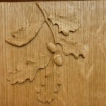 Carved detail to Bookcase end panel.
