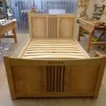 Double bed , Oak frame and panelswith American walnut to create the Mackintosh type feature.