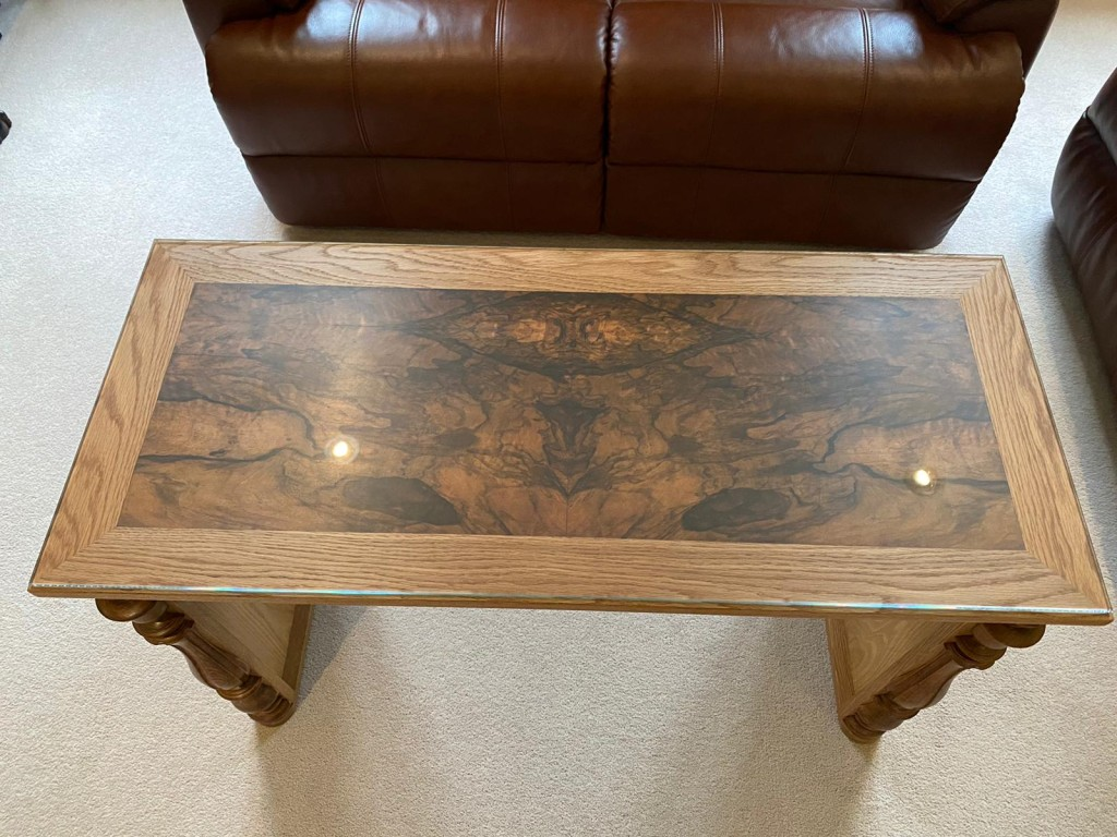Top of this table is the front panel from an old Harmonium, a lovely burr French walnut veneer, protected by a glass top.